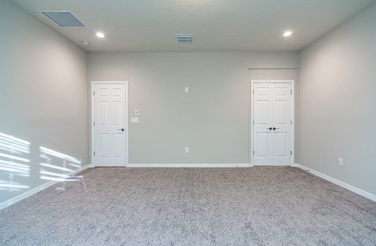 Redwood quick move-in Master bedroom with gray carpet