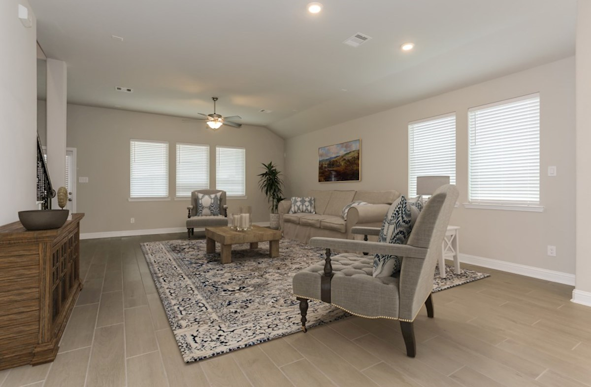 Bonbrook Lakes Berkshire great room with tile flooring and ceiling fan