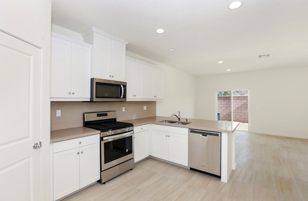 Bristol quick move-in Gourmet kitchen boasts an oversized island, stainless steel appliances, and stunning granite countertops