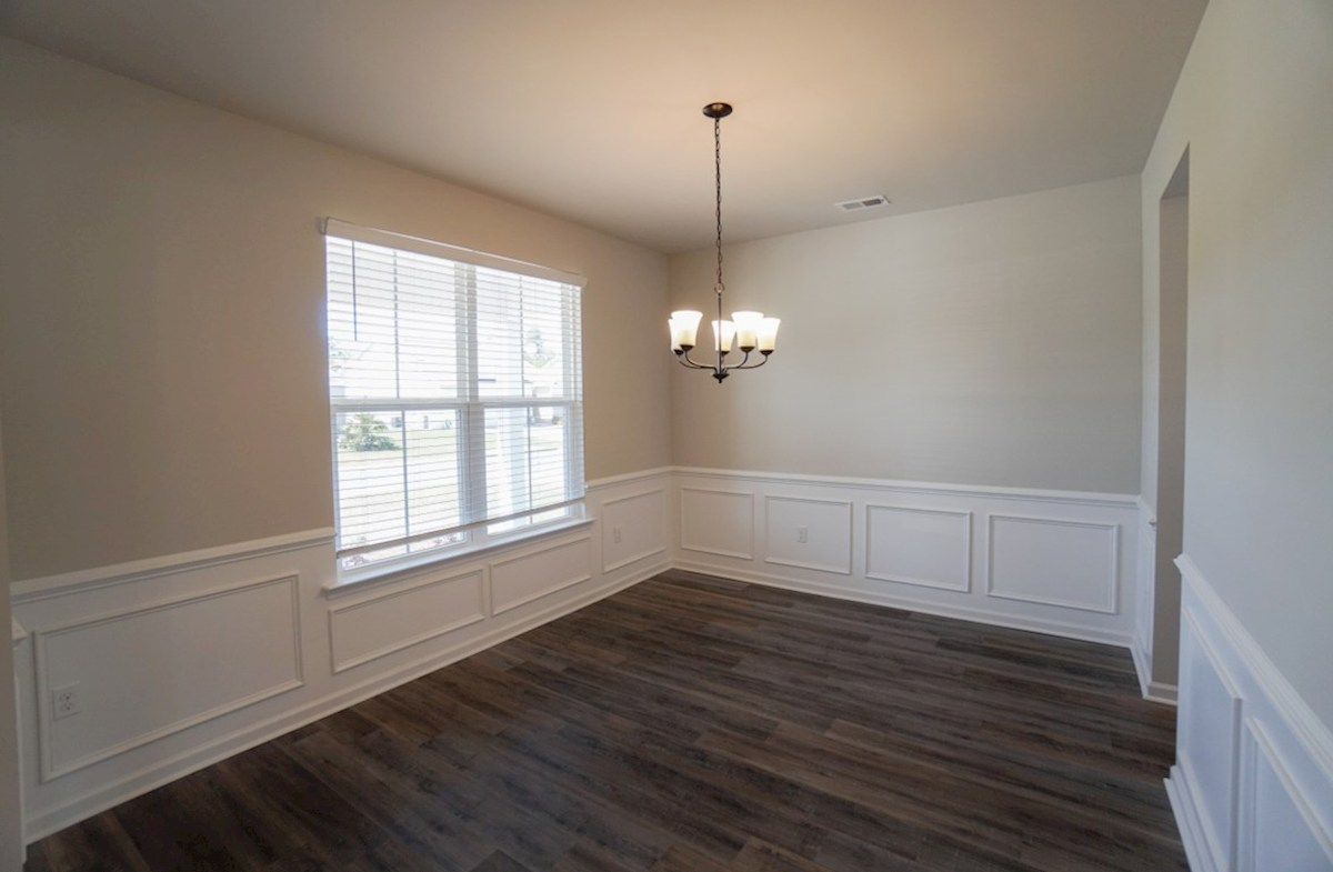 Edisto quick move-in dining room features chair rail trim