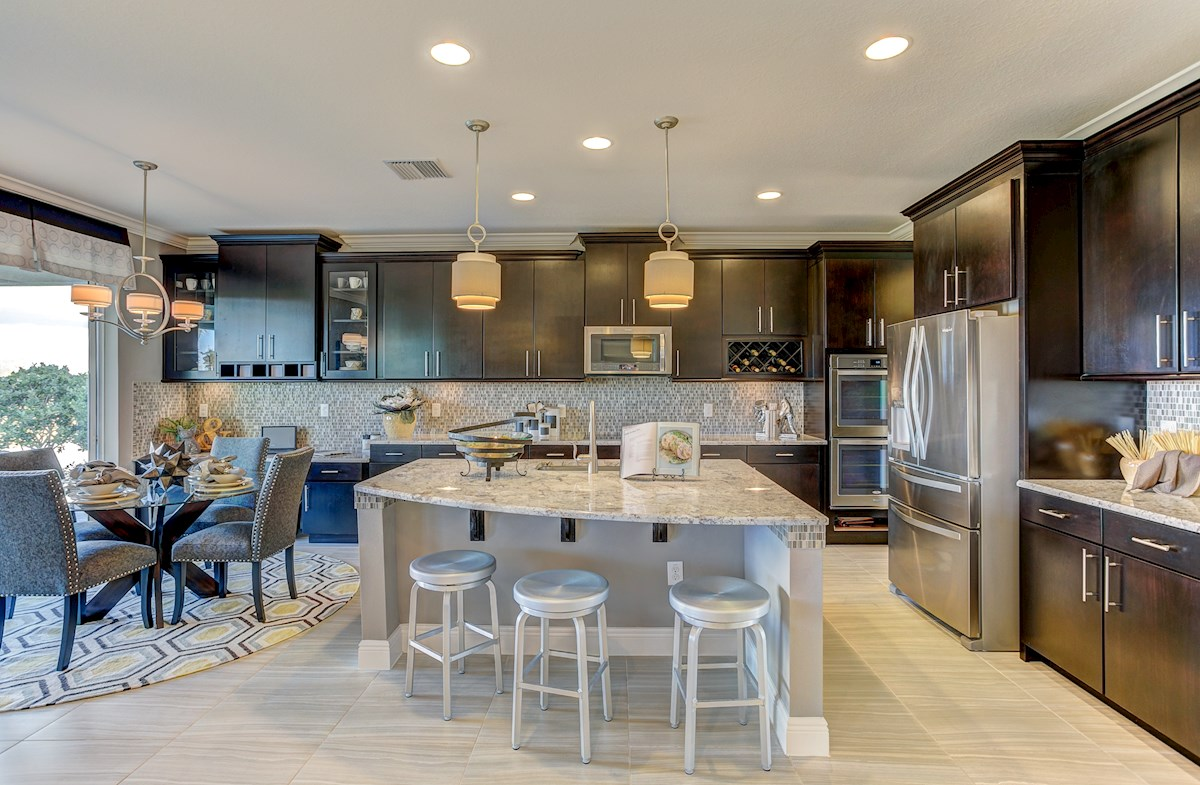 open kitchen with dark cabinets and center island