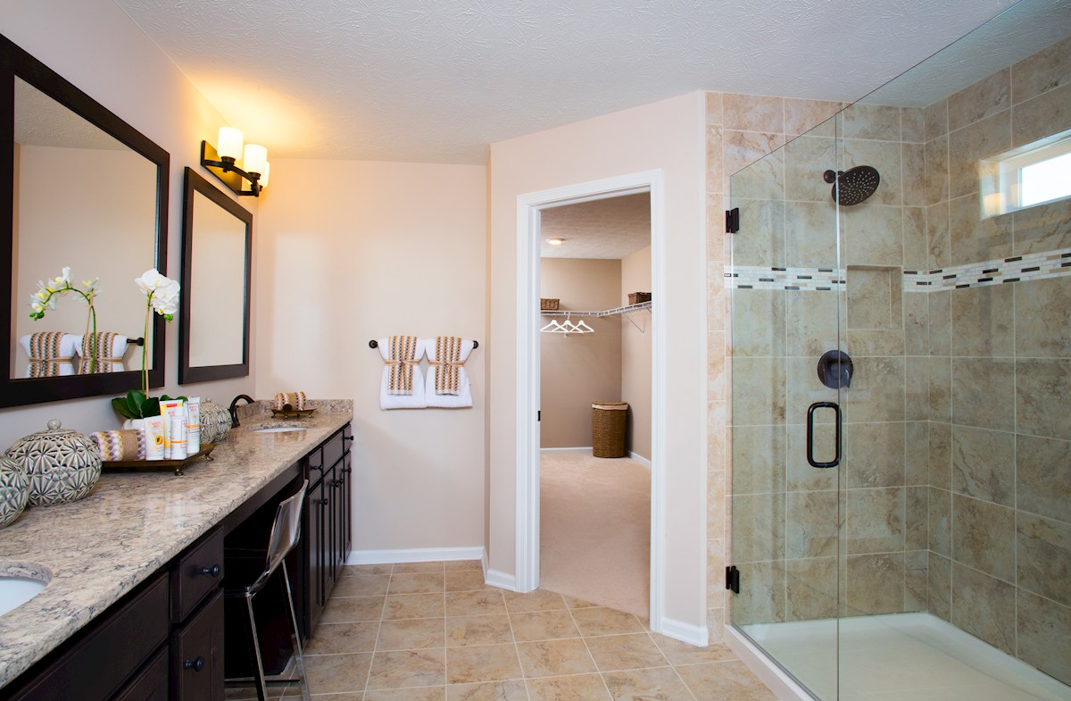 master bath with spa shower and dual vanities