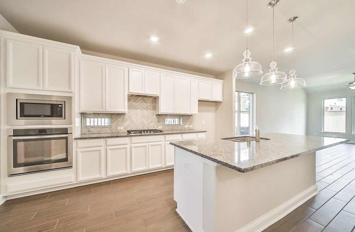 Magnolia quick move-in modern kithchen with granite countertops and pendant lighting