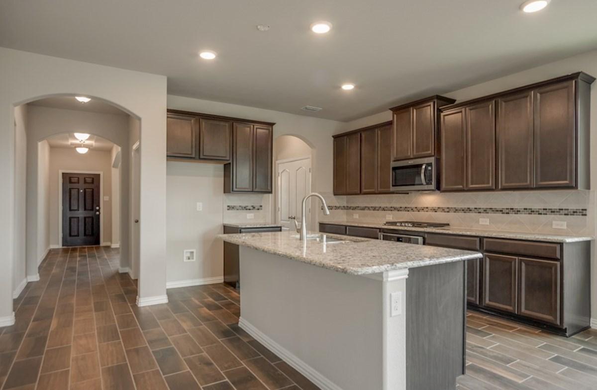 Prescott quick move-in open kitchen with island and dark cabinets