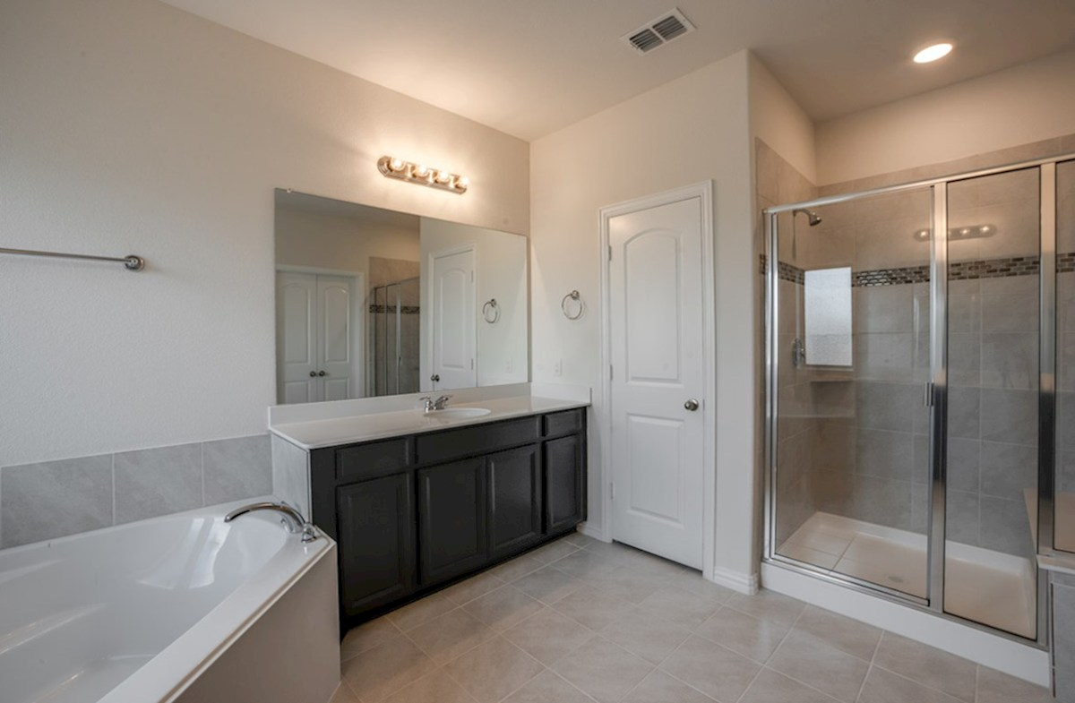 Kerrville quick move-in master bath with separate tub and shower