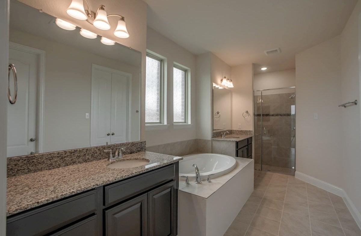 Stoney Creek Degrey Degrey master bathroom with large soaking tub