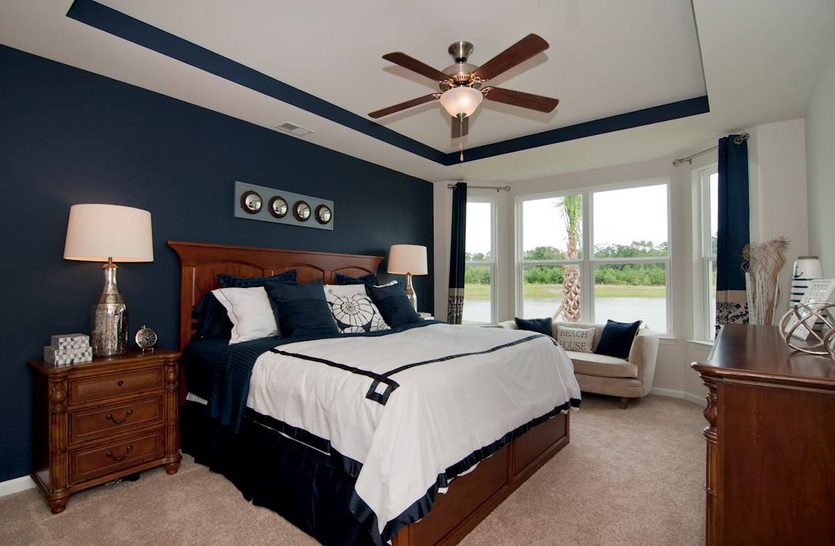 Cameron Village Millbrook master bedroom with tray ceiling and bay windows