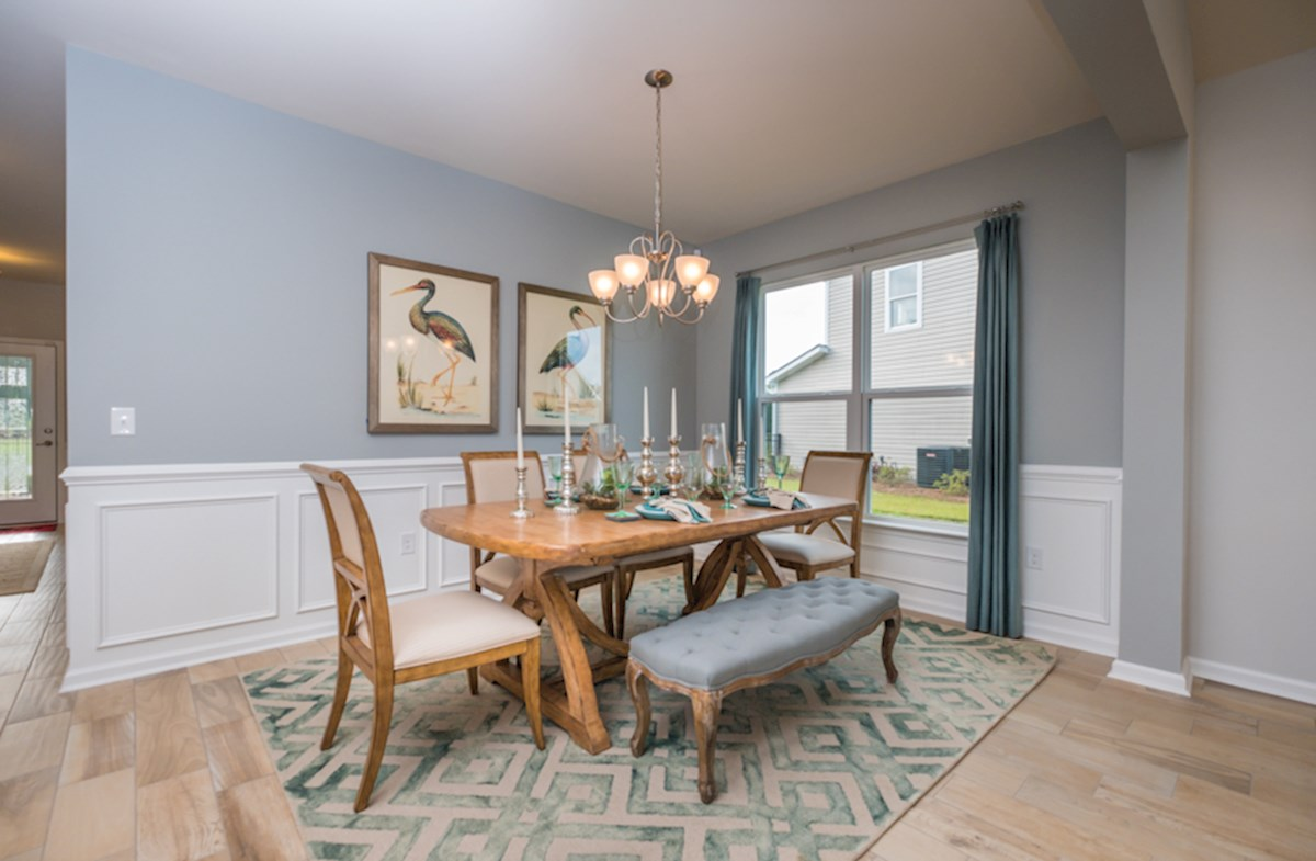formal dining room with picture frame trim