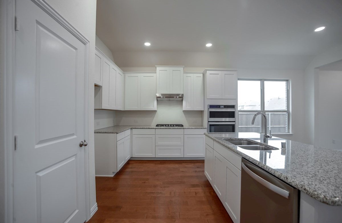 Silverado quick move-in open kitchen with white cabinets and large island