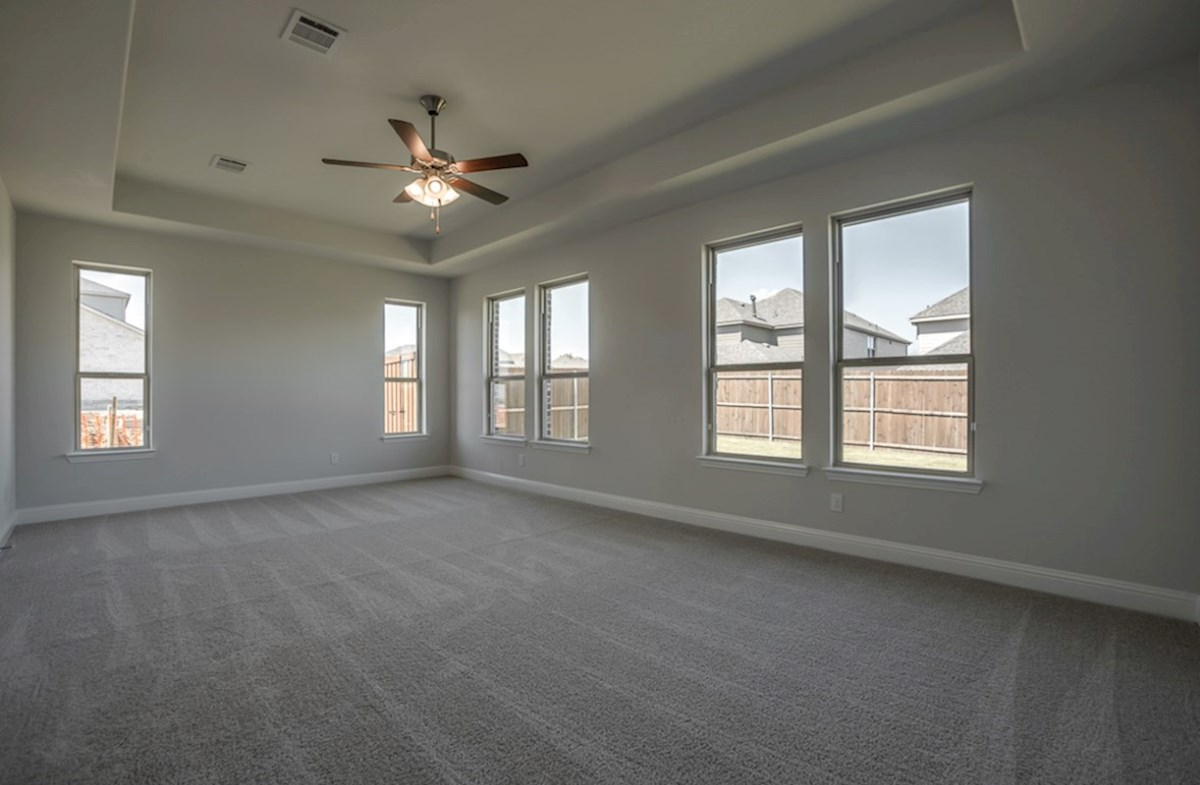 Kerrville quick move-in master bedroom with carpet and ceiling fan