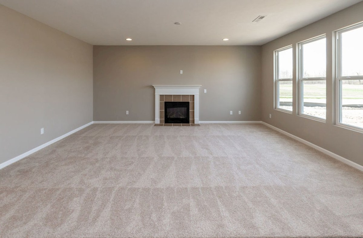 Lawrence quick move-in Cozy fireplace completes this great room