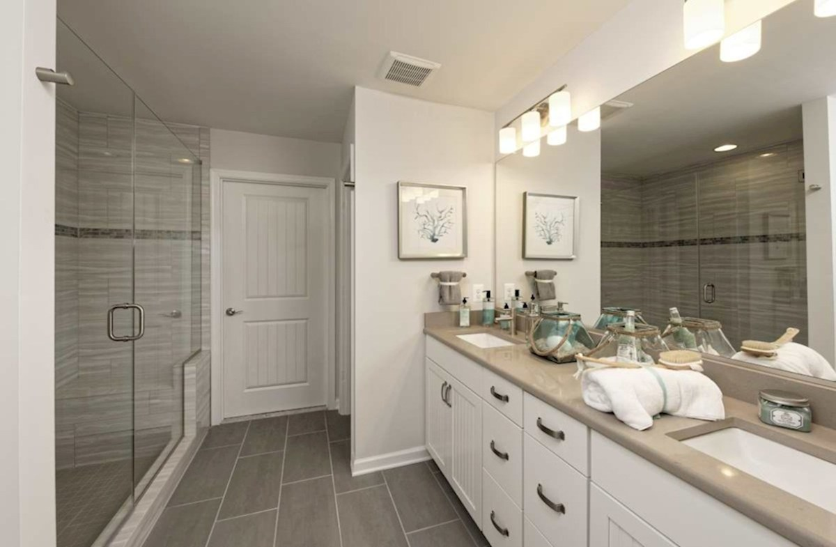 Harbor Crest at Bayside Fenwick Spa-inspired master bath featuring dual vanities