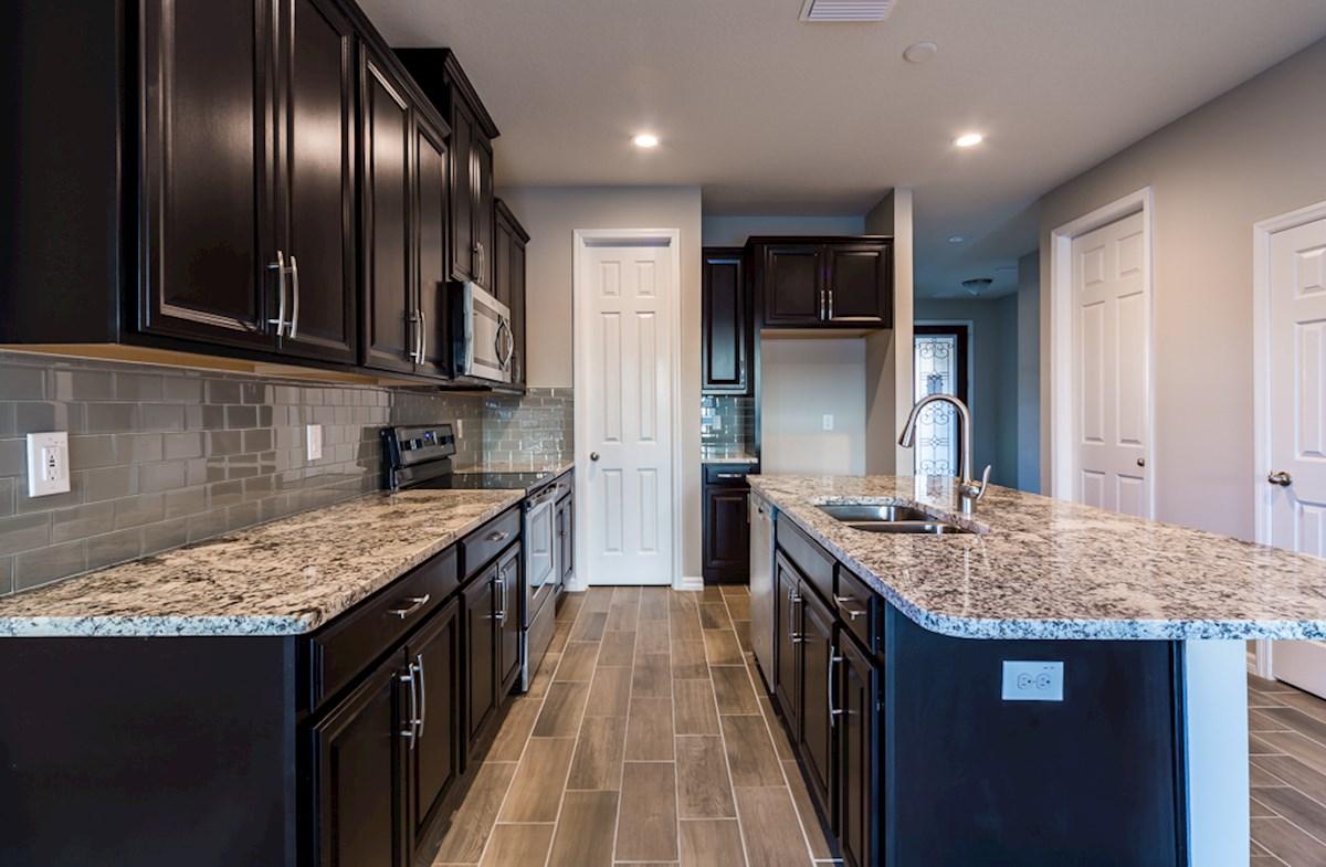 St. Augustine III quick move-in Kitchen boasts granite and plenty of espresso cabinets