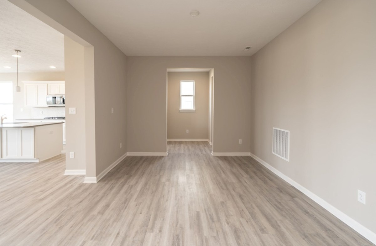 Greenwich quick move-in open formal dining room with hardwood floors