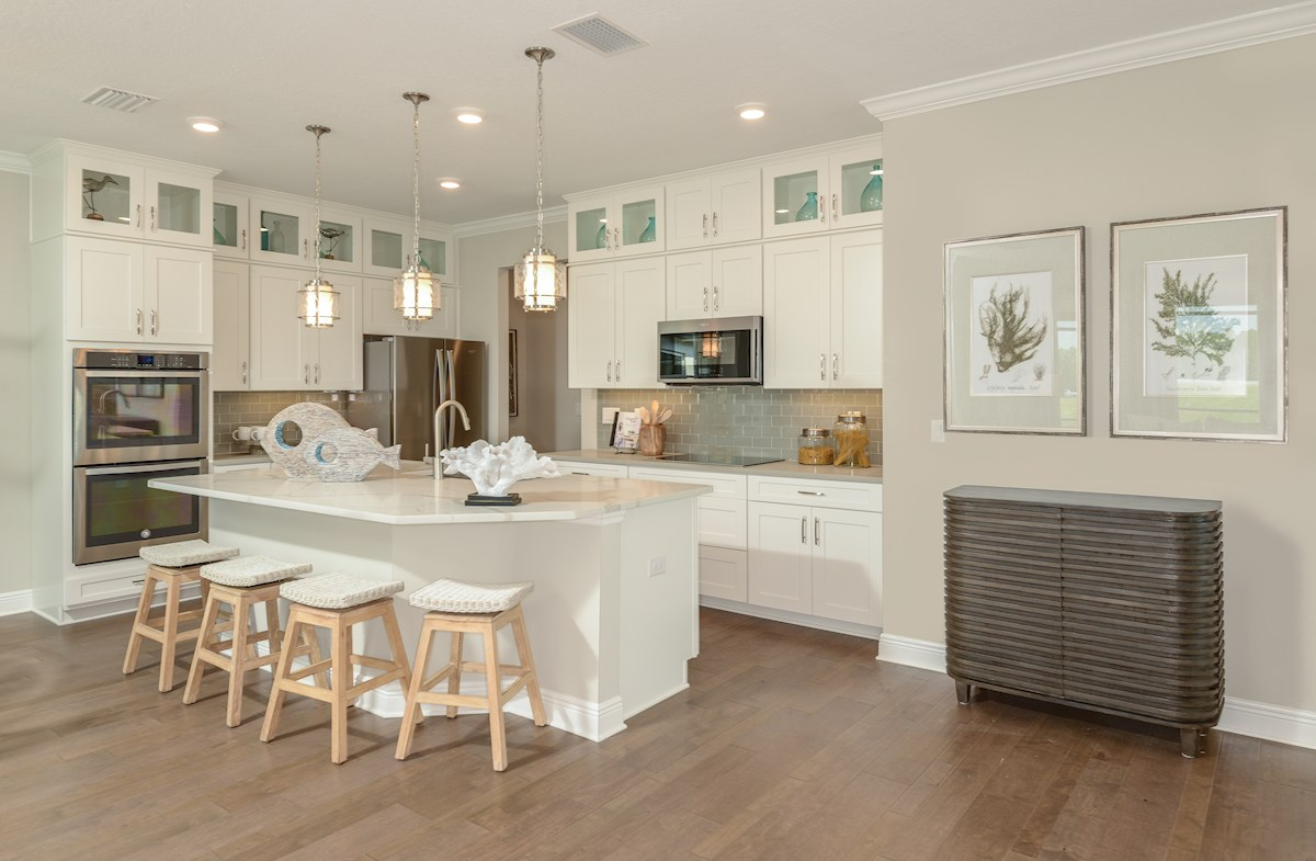 Open kitchen with center island and white cabinets