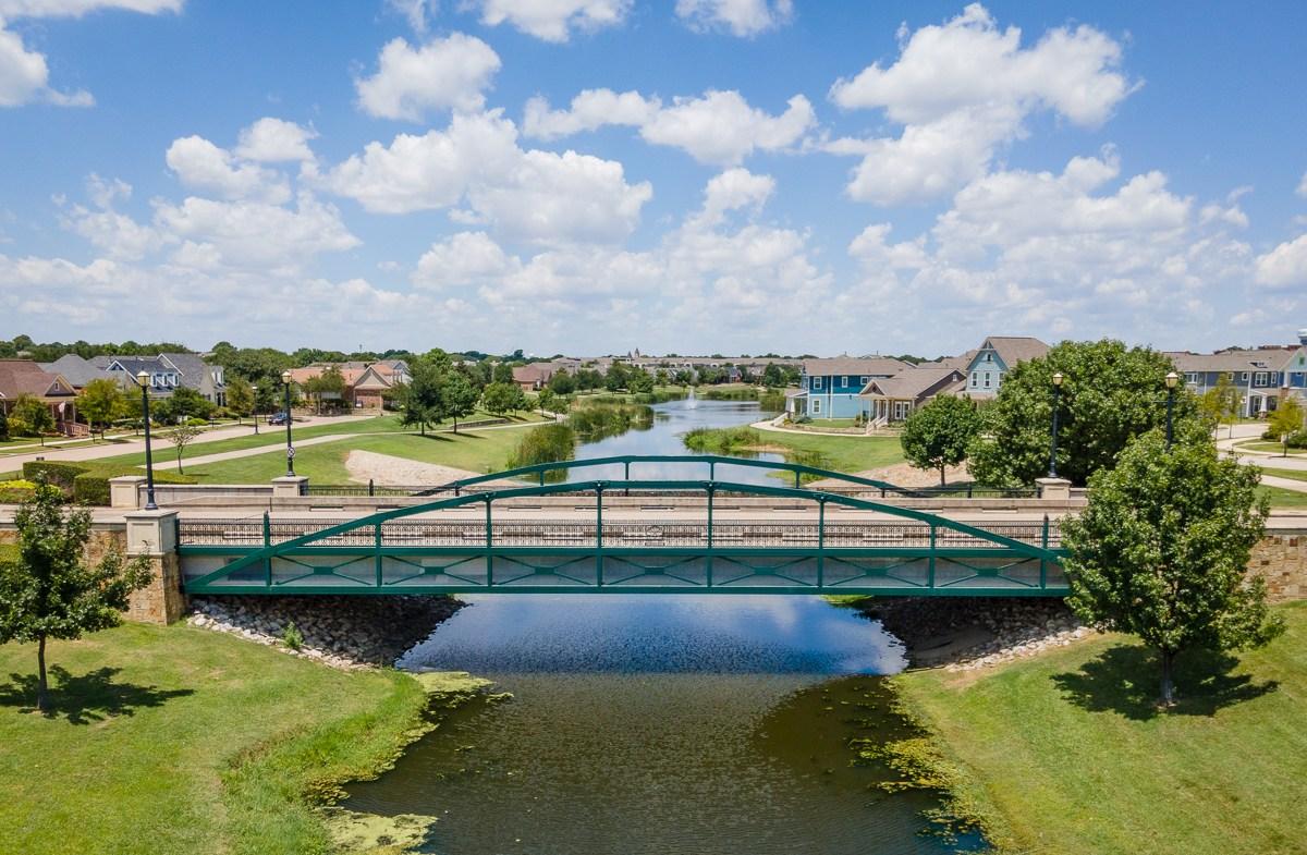 community pond with pedestrian bridge