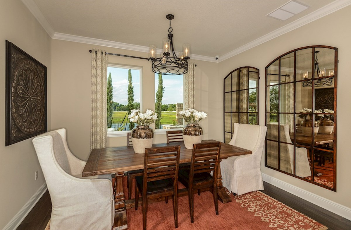 Avalon Park West Sea Breeze Dining room with back yard views