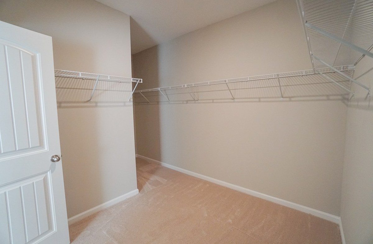 Summerton quick move-in walk-in closet features plenty of storage space