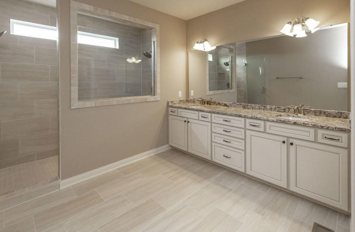 Kessler quick move-in Sparkling master bath with large tiled shower