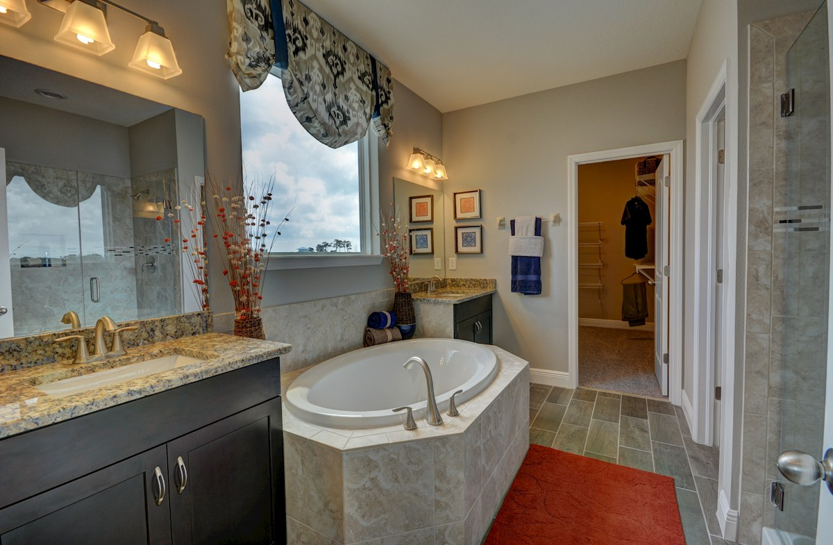 Long Lake Ranch Anna Maria Master bathroom with garden tub and glass enclosed shower