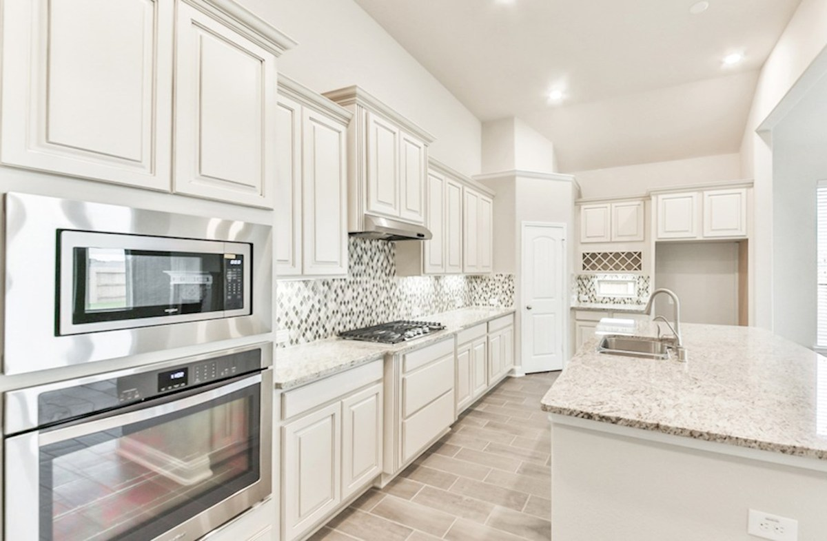 Cameron quick move-in kitchen with granite countertops and wine rack