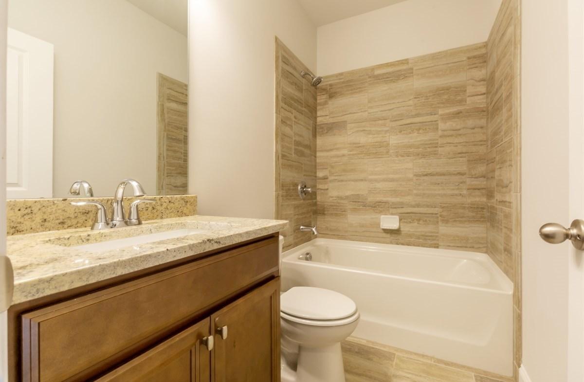 Piedmont quick move-in Secondary Bathroom with granite countertops