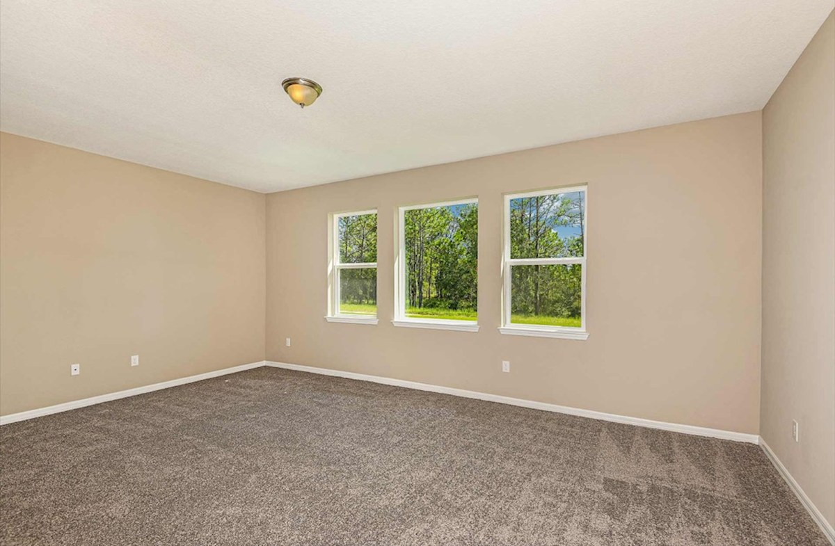 Shoreline quick move-in Master bedroom with large window and backyard views