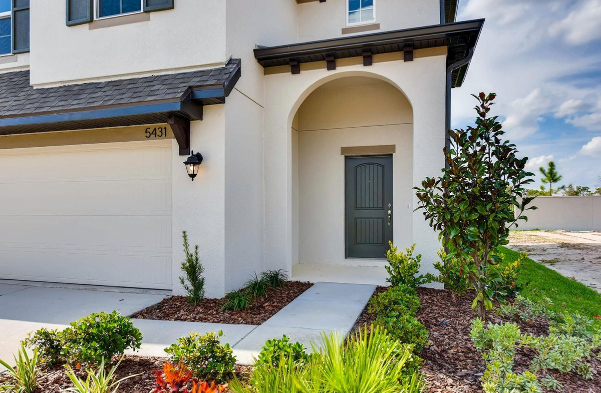 Cypress Pointe quick move-in Front entry with decorative entry door