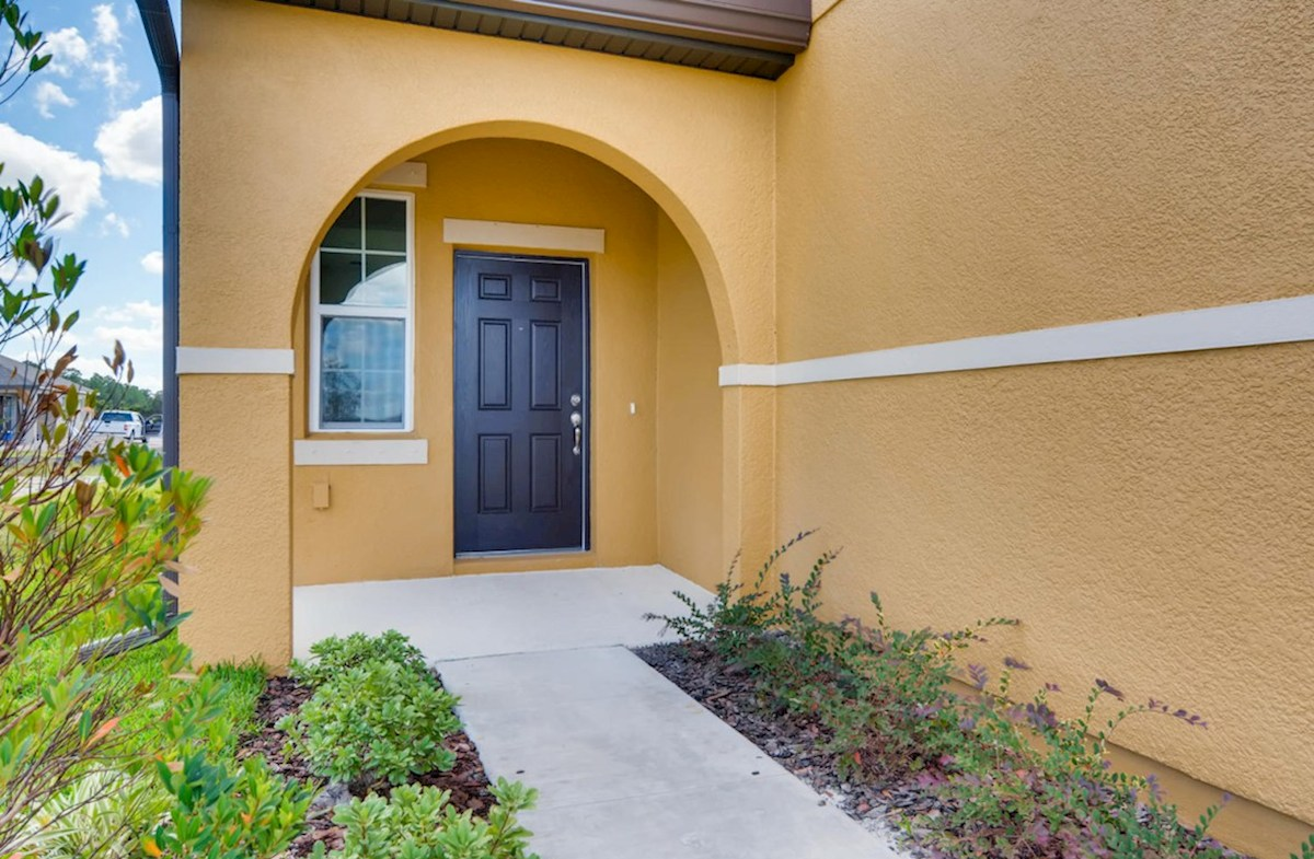 Captiva quick move-in Entry way with lead walk, land scaping and front porch
