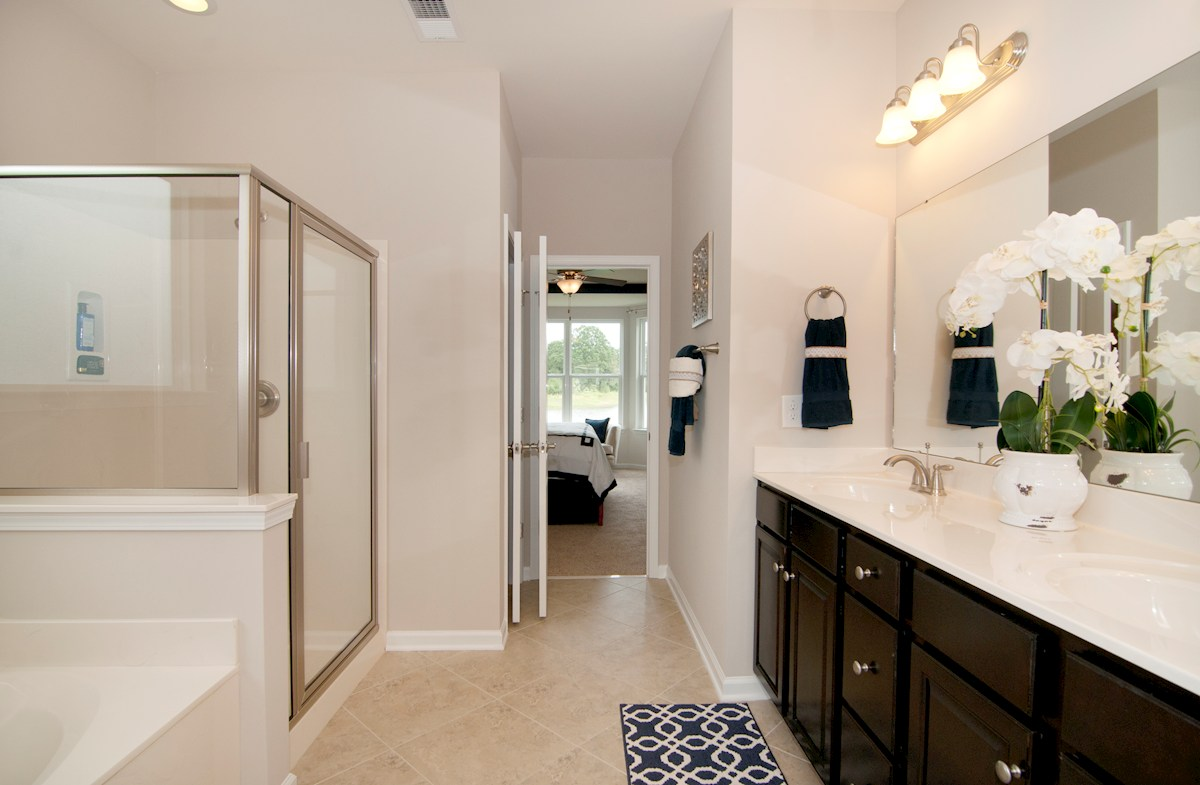 Cameron Village Millbrook separate shower and bathtub in the master bathroom