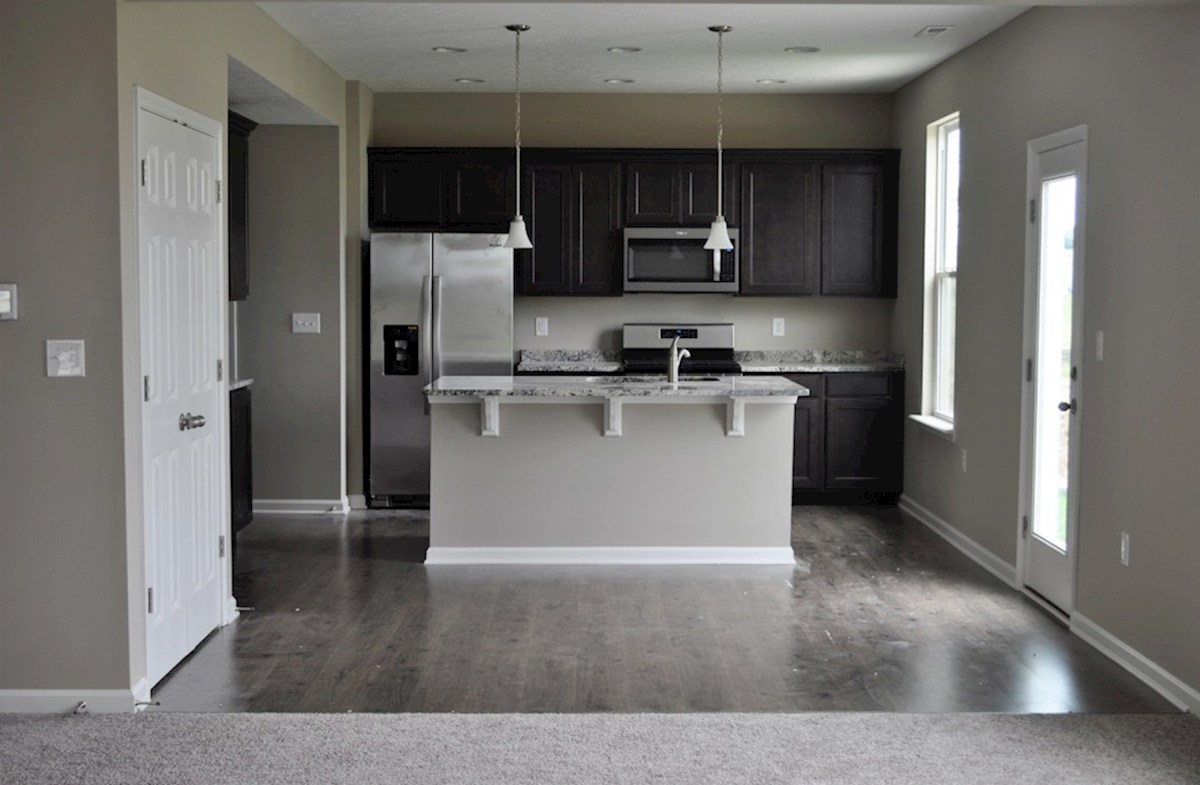 Juniper quick move-in Open kitchen with stainless steel appliances