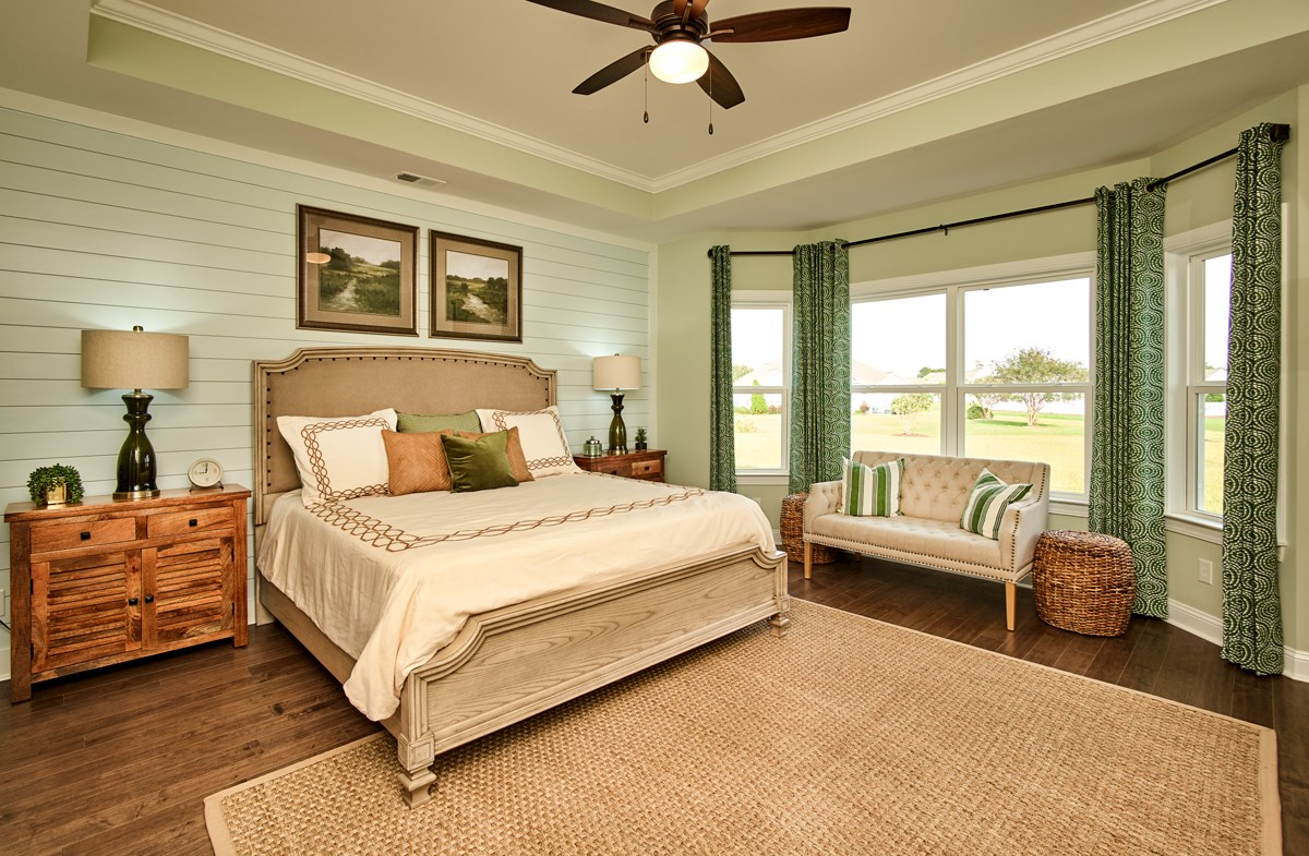 master bedroom features bay windows
