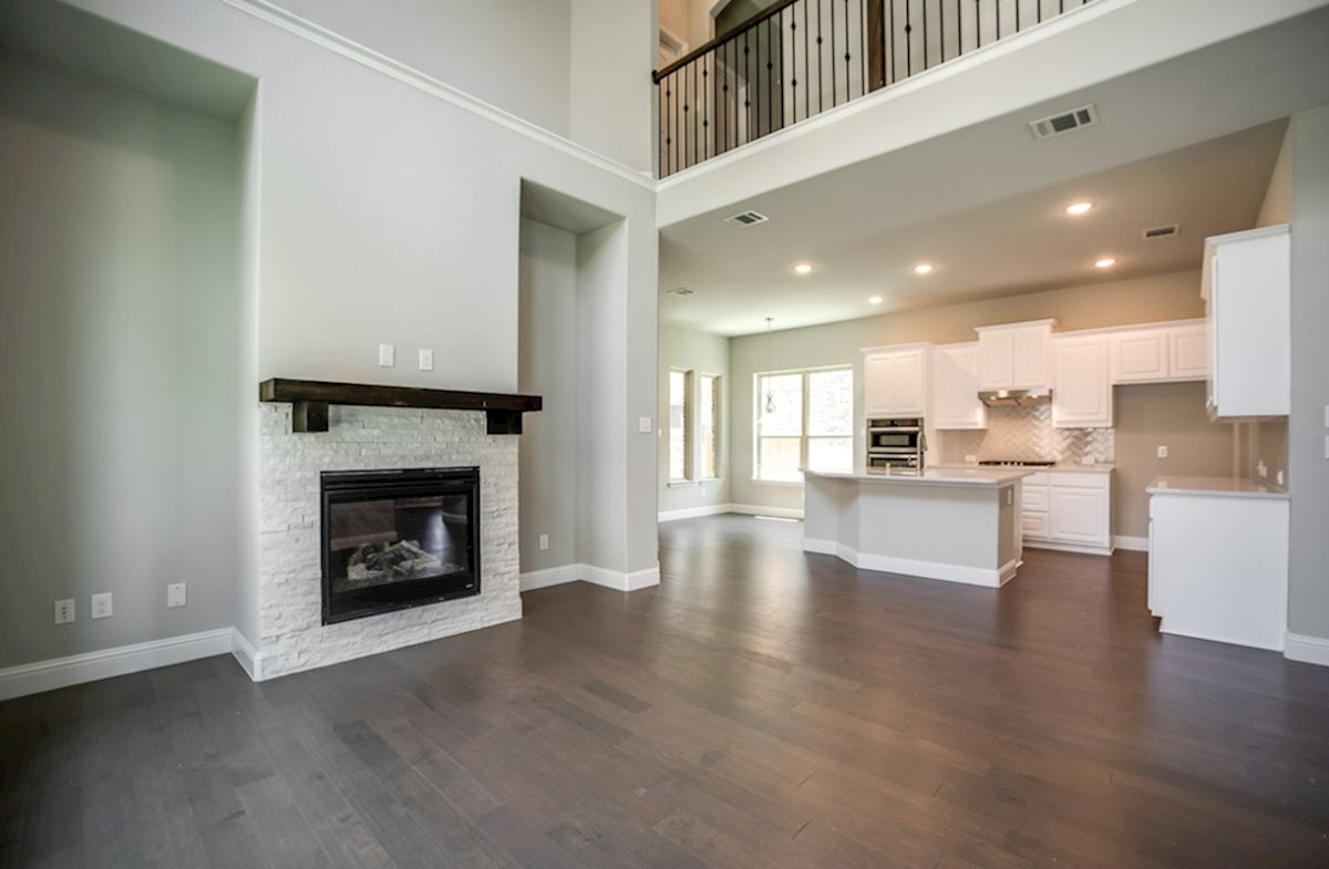 Hamilton quick move-in open great room with stone fireplace and wood mantle