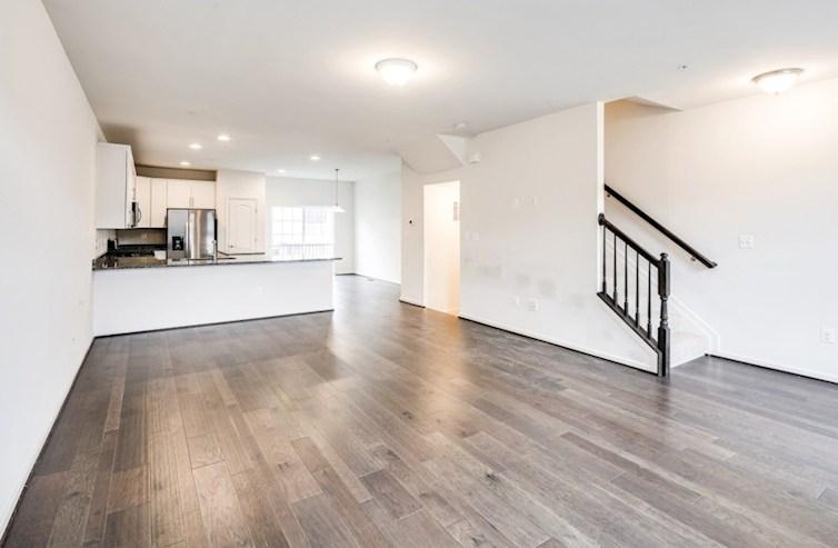 Oakland II  quick move-in Open floorplan featuring hardwood floors