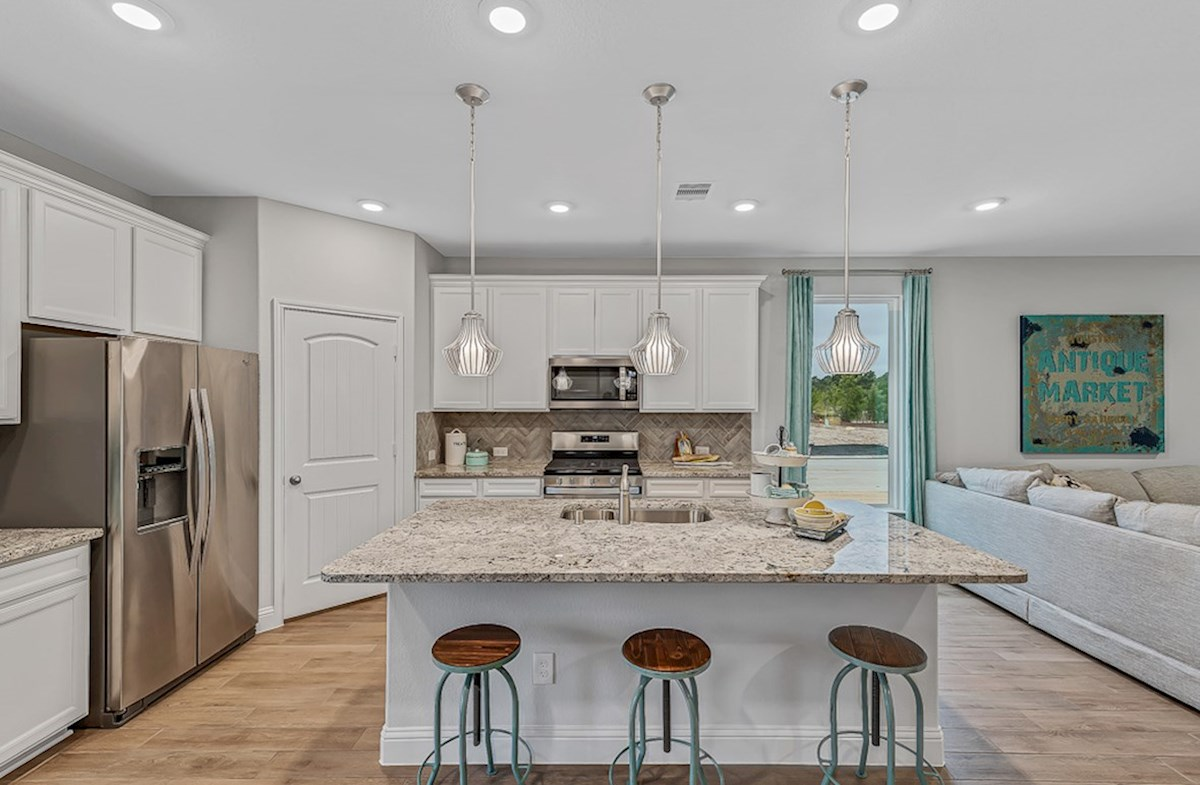 Bridgeland: Harmony Grove Grand Rouge open kitchen with granite countertops