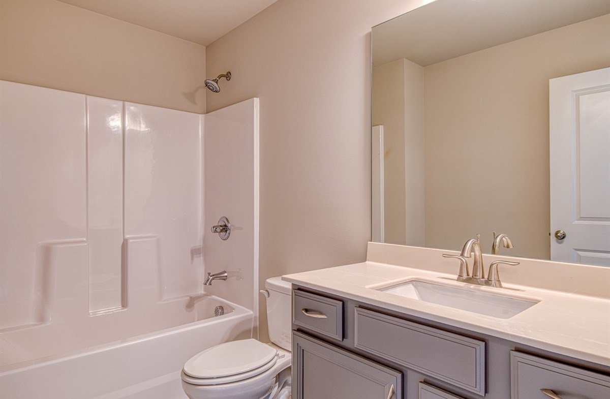 Lexington quick move-in Secondary Bathroom with gray cabinets