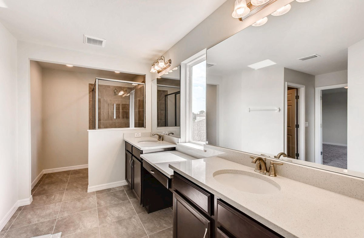 Cypress Pointe quick move-in Spa-inspired master bathroom with walk-in shower and dual vanity