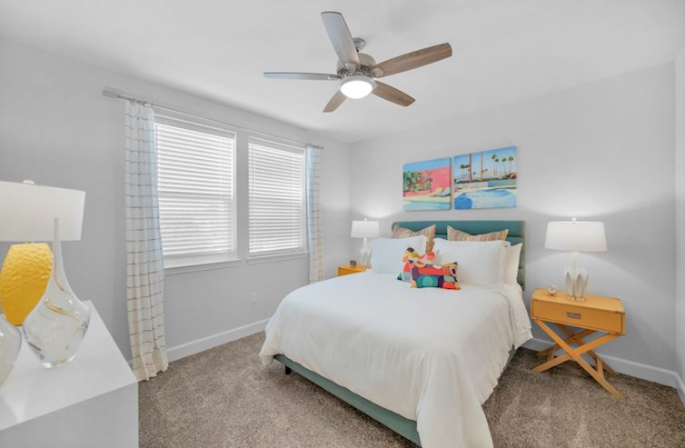 Sherwood secondary bedroom with carpet floors and ceiling fan