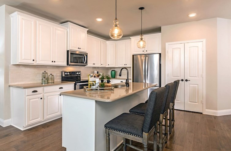 Gatherings® at Westview Wiltshire kitchen with white cabinetry and pendant lighting