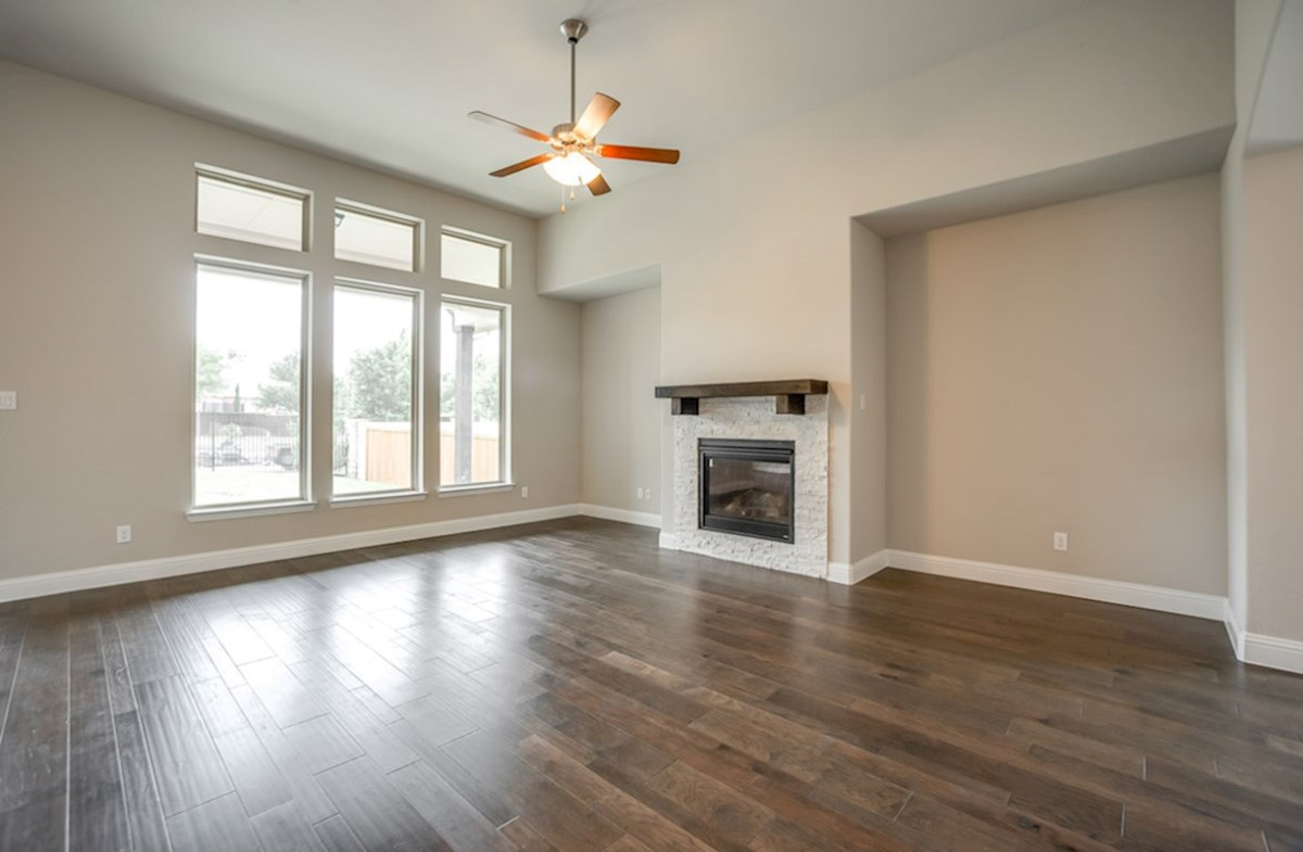 Bandera quick move-in great room includes wood flooring and fireplace