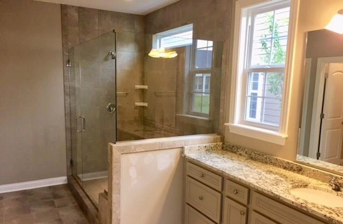 Windsor quick move-in Spa inspired master bath with tiled shower