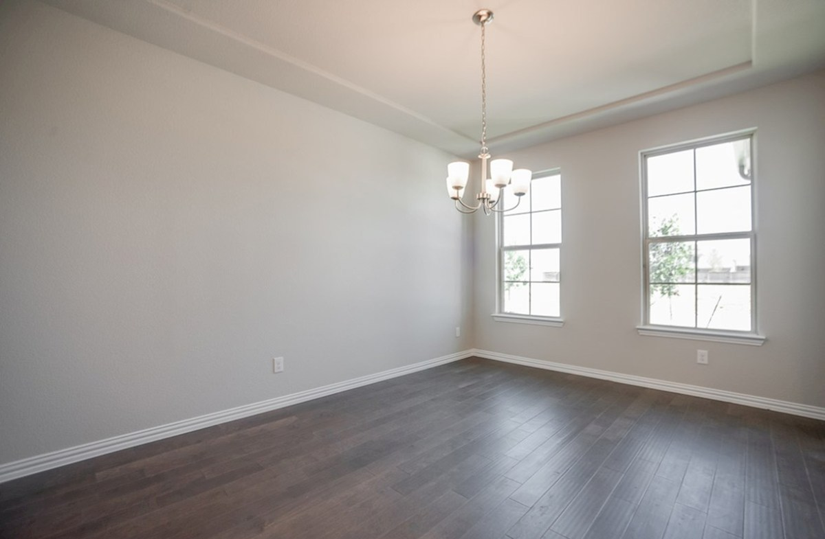 Prescott quick move-in Prescott formal dining room with tray ceiling and wood flooring