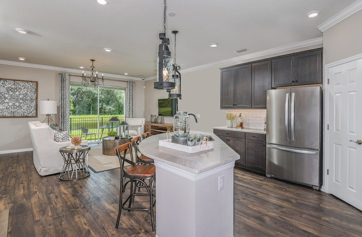 Kemerton Place Siesta Key Kitchen island opens to the great room