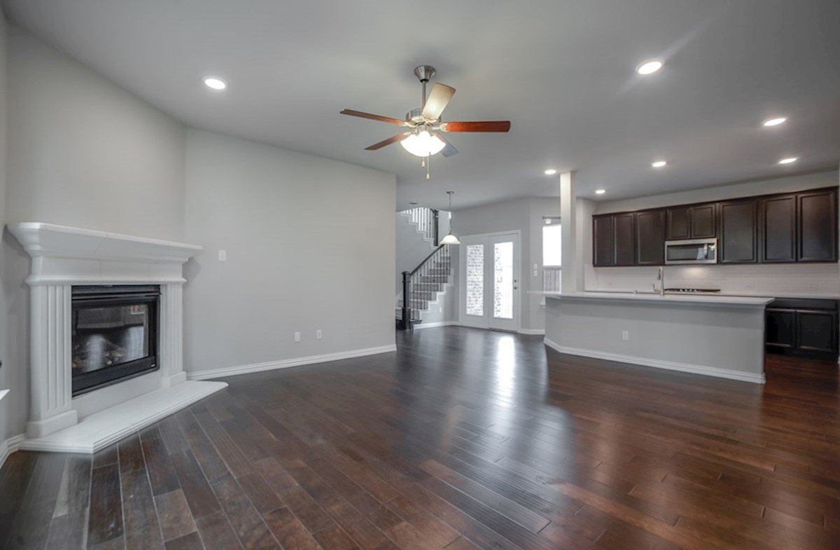 Eastland quick move-in open great room with wood floors and fireplace