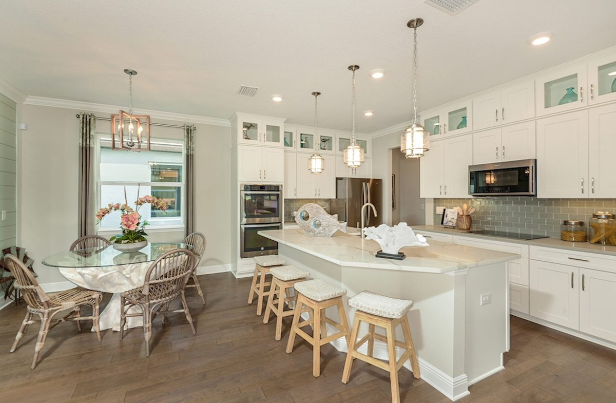 Reserve at Citrus Park Lucia Bay Kitch with large island and white cabinets with eat-in area