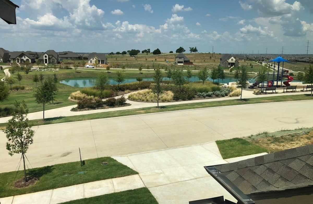 Madison quick move-in view of the playground and pond from upstairs