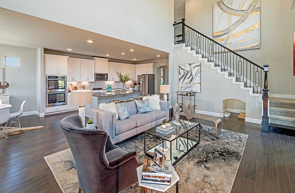 The Grove at Craig Ranch Brazos Brazos open great room with staircase to second floor