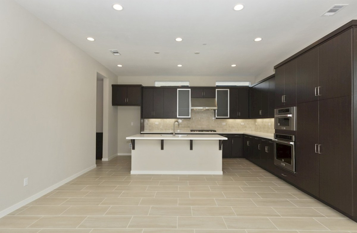 Residence 1 quick move-in The kitchen features spacious countertops and a walk-in pantry to maximize storage