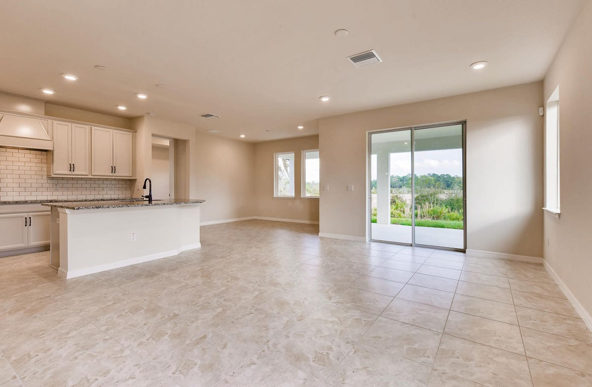 Sea Breeze quick move-in Open kitchen, great room and dining room with tile flooring