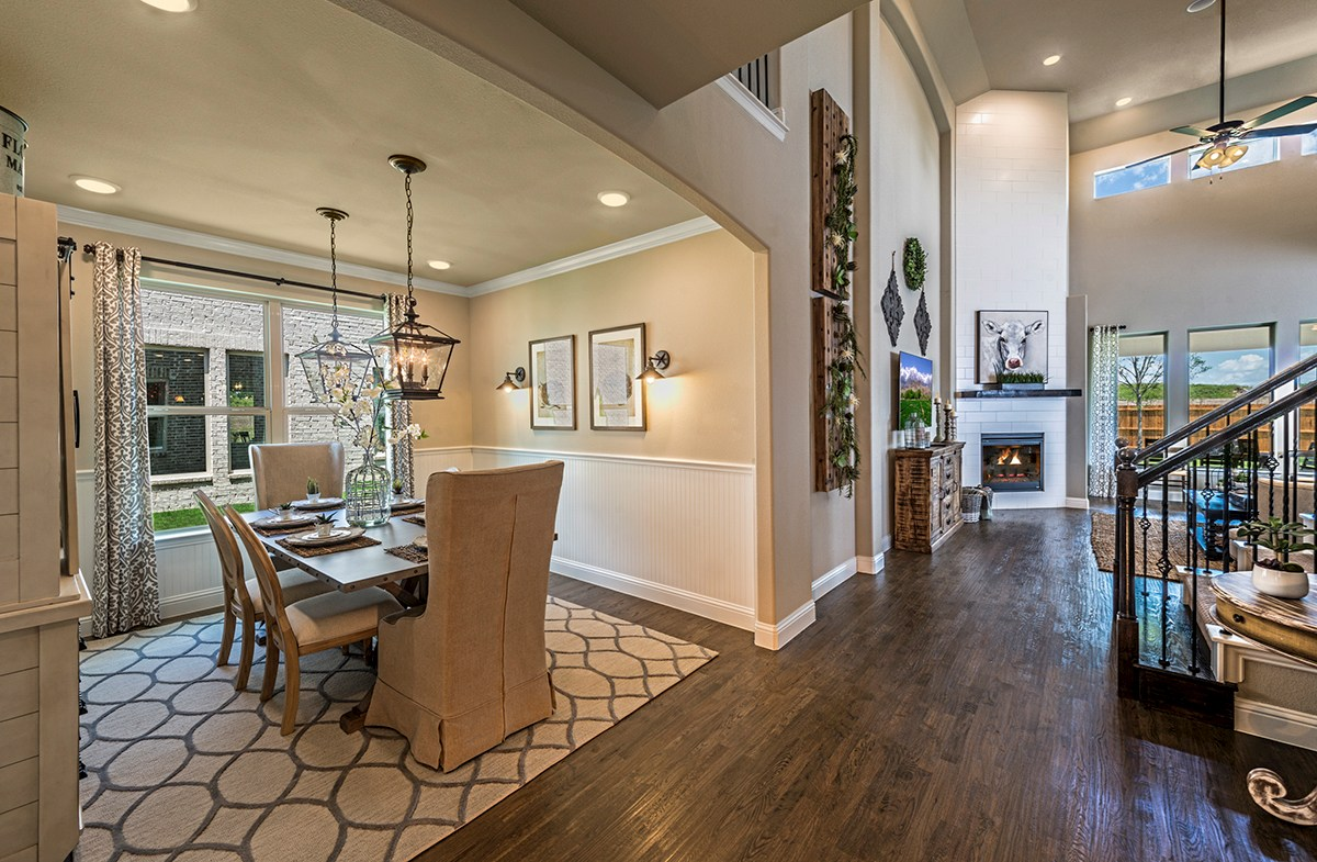 Summerfield dining room boasts wood flooring